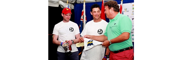 Shane McCarthy & Andy Davis, GP14 World Champions 2016, present GSC burgee in Barbados